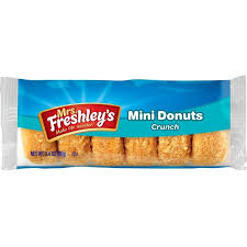 Tiernos y esponjosos mini donuts cubiertos de coco tostado crujiente.